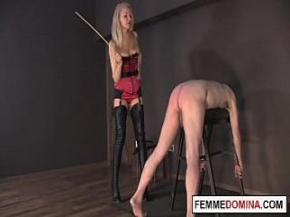 Mean dominatrix whipping worthless slave ass without mercy